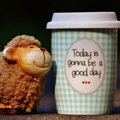 "Happy sheep figurine next to coffee cup ""Today is gonna be a good day"""